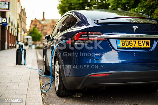Coventry, UK - August 31, 2018: Coventry City Centre Tesla electric vehicle parking area and charging from street electrical dock.