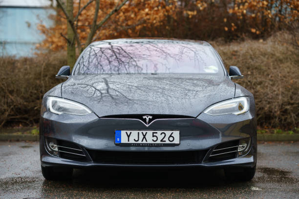Tesla Electric Car parked on car park in industrial area near port Gothenburg, Sweden - March 15, 2019: Tesla Electric Car parked on car park in industrial area near port tesla motors stock pictures, royalty-free photos & images