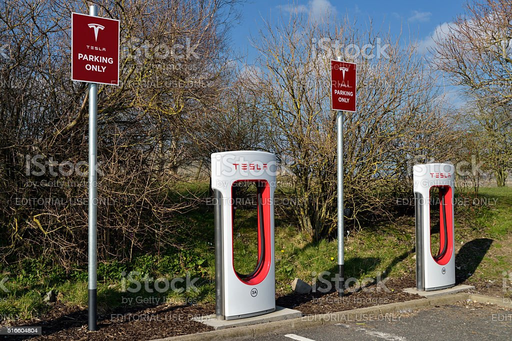 Tesla electric car supercharger in a service station stock photo