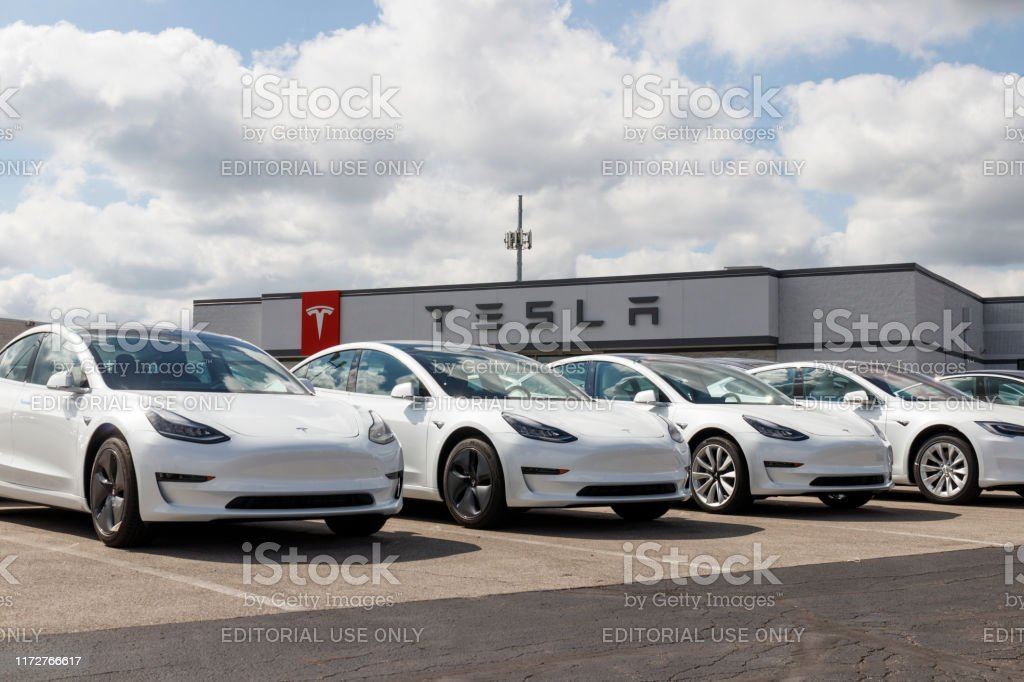Tesla electric vehicles awaiting preparation for sale. Tesla EV Model 3, S and X are a key to a cleaner and greener environment XI Indianapolis - Circa September 2019: Tesla electric vehicles awaiting preparation for sale. Tesla EV Model 3, S and X are a key to a cleaner and greener environment XI Battery Stock Photo