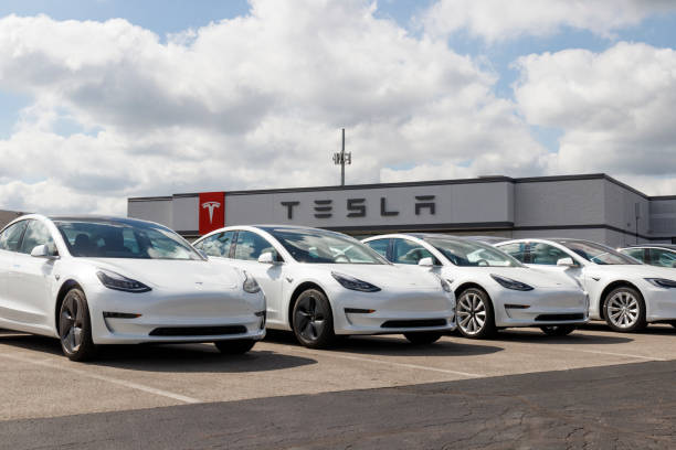 Tesla electric vehicles awaiting preparation for sale. Tesla EV Model 3, S and X are a key to a cleaner and greener environment XI stock photo
