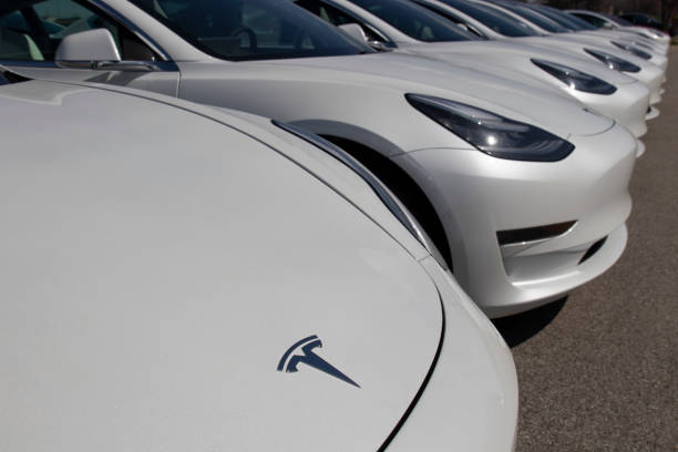 Tesla electric vehicles awaiting preparation for sale. Tesla EV Model 3, S and X are a key to a cleaner and greener environment. Indianapolis - Circa April 2020: Tesla electric vehicles awaiting preparation for sale. Tesla EV Model 3, S and X are a key to a cleaner and greener environment. tesla model s stock pictures, royalty-free photos & images