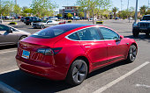 An editorial stock photo of a Tesla Model 3 parked in a parking lot in Las Vegas, NV.