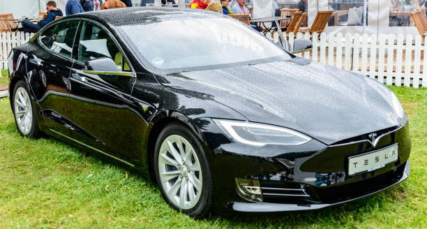 Tesla Model S all-electric luxury saloon car front view Tesla Model S  all-electric, luxury, saloon car in black. The Model S is one of the world's top selling plug-in electric cars and is fitted with All Wheel Drive and autopilot. The car is on display during the 2017 Classic Days at Schloss Dyck. People in the background are looking at the cars. tesla model s stock pictures, royalty-free photos & images