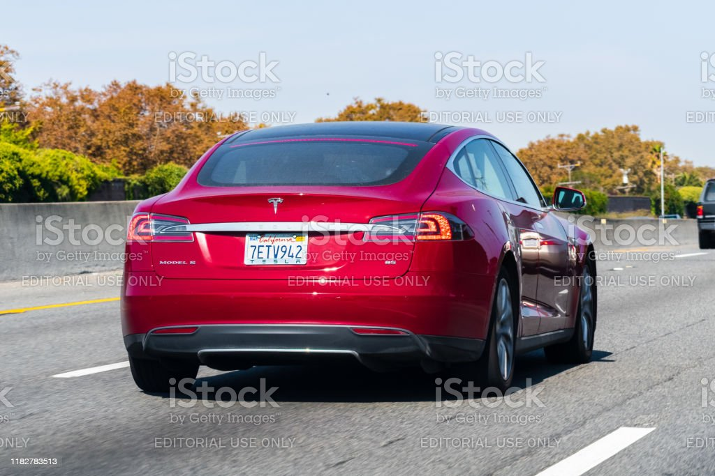 Tesla Model S driving on the freeway Oct 12, 2019 Redwood City / CA / USA - Tesla Model S driving on the freeway in Silicon Valley Back Stock Photo