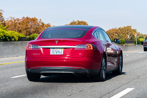 Tesla Model S Driving On The Freeway Stock Photo - Download Image Now