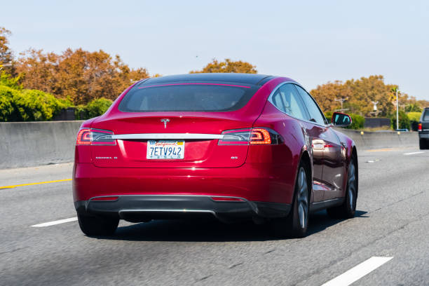 Tesla Model S driving on the freeway Oct 12, 2019 Redwood City / CA / USA - Tesla Model S driving on the freeway in Silicon Valley tesla model s stock pictures, royalty-free photos & images