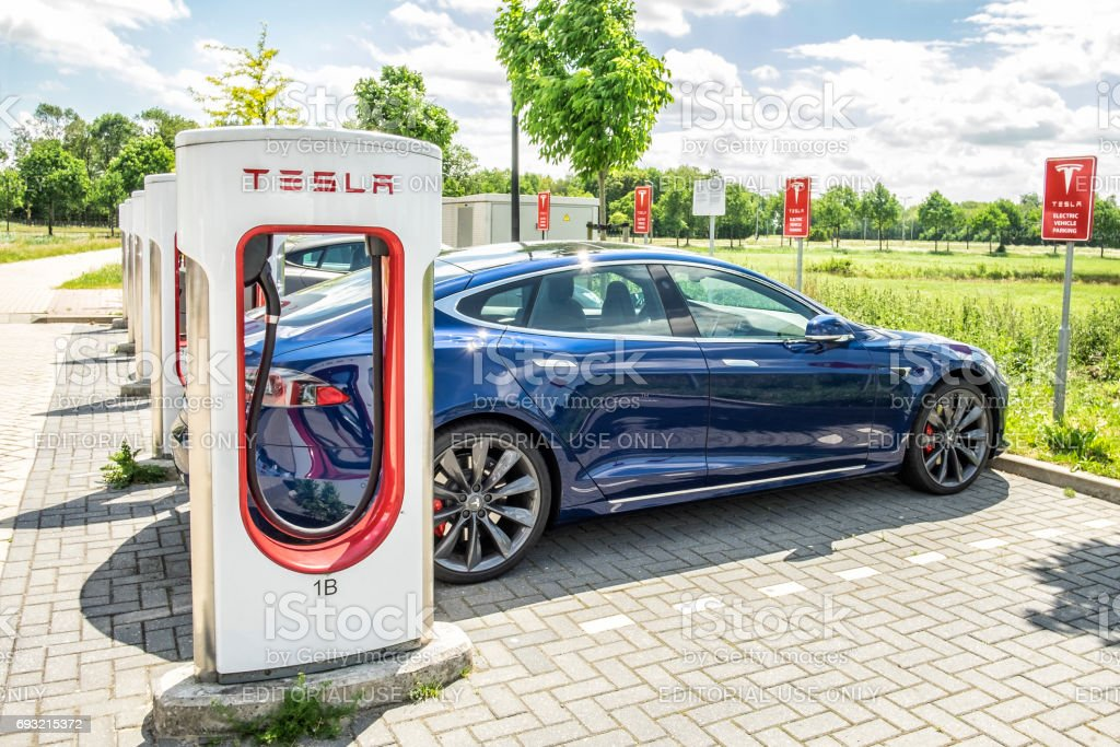 Tesla Model S Electric Car At A Supercharger Charging ...
