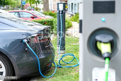Tesla Model S electric car at an electric vehicle charging station in the city center of Zwolle, The Netherlands.