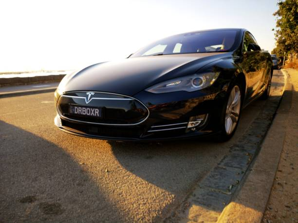 Tesla Model S Hybrid Vehicle Melbourne, Australia: March 05, 2019: Tesla Model S parked on a street in the suburb of St Kilda in Melbourne. Tesla Motors are one of the leading designers and manufacturers of electric hybrid vehicles in the world. tesla model s stock pictures, royalty-free photos & images