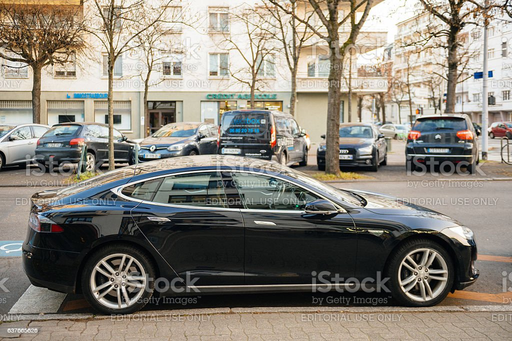 Tesla Model S in central city parked stock photo