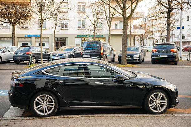 Tesla Model S in central city parked Strasbourg, France - December 19, 2016: New Tesla Model S car parked on French street. Tesla is one of the most expensive electric car in the world and is highly acclaimed by driver for it comfort and pleasure to drive tesla model s stock pictures, royalty-free photos & images