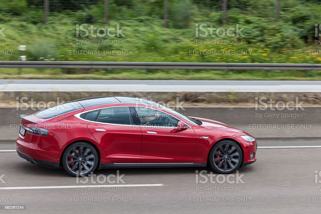 Tesla Model S on the highway Frankfurt, Germany - July 12, 2016: Tesla Model S luxury electric sedan  Autobahn Stock Photo