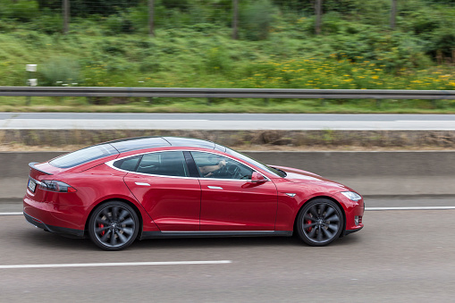 Tesla Model S On The Highway Stock Photo - Download Image Now