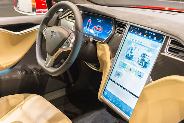 Tesla Model S P90D full electric luxury car dashboard Brussels, Belgium - Januari 12, 2016: Dashboard on a Tesla Model S P90D full electric luxury car. The car is fitted with a large touch screen and dashboard screen. The car is on display during the 2016 Brussels Motor Show. tesla model s stock pictures, royalty-free photos & images