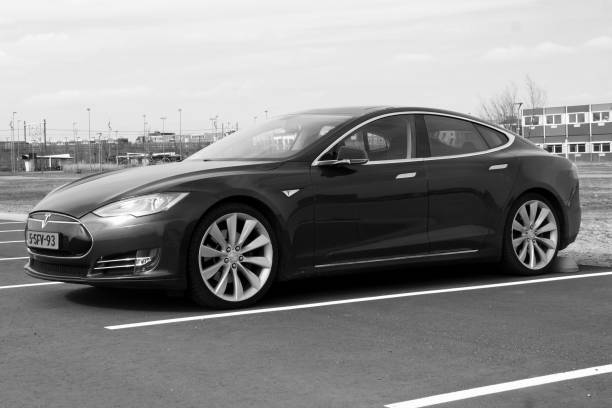 Tesla model S Almere, The Netherlands - March 17, 2018:  Electric Tesla Motors Model S parked on a parking lot (black white). Tesla Motors is an American automotive and energy storage company. tesla model s stock pictures, royalty-free photos & images
