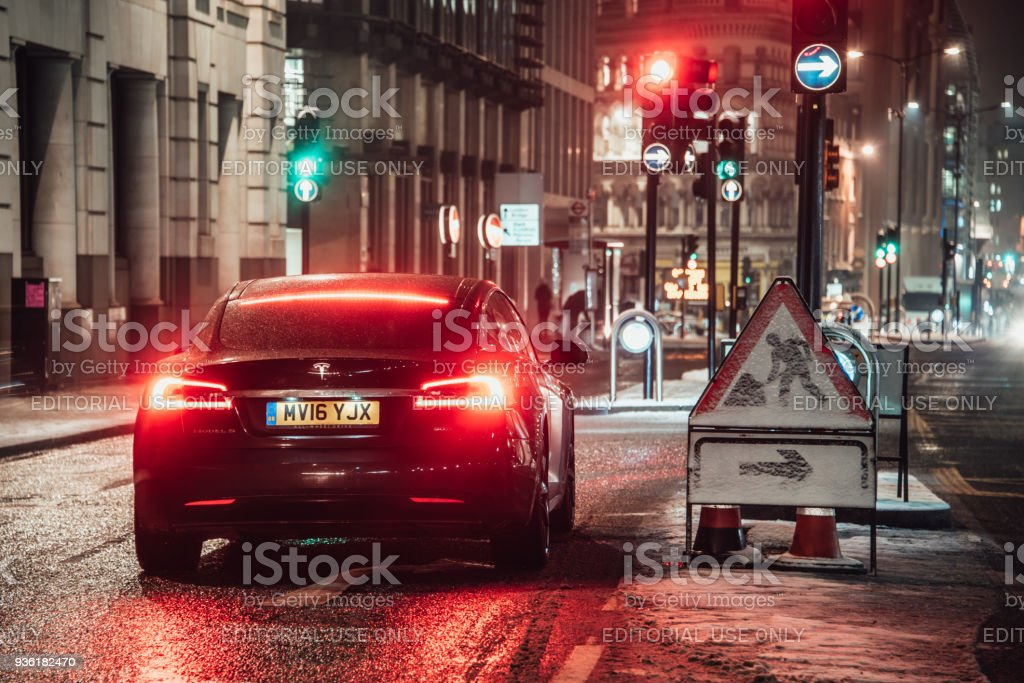 Tesla Model S London, England. 02 March 2018 - A Tesla Model S electric car stopped in a street of London, England, at night. Alternative Fuel Vehicle Stock Photo