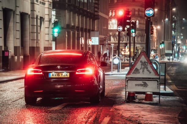 Tesla Model S London, England. 02 March 2018 - A Tesla Model S electric car stopped in a street of London, England, at night. tesla motors stock pictures, royalty-free photos & images