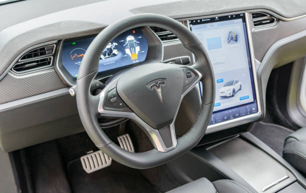 Tesla Model X all-electric crossover SUV interior Interior on a Tesla Model X all-electric crossover SUV with large electronic touch screens on the dashboard and luxurious leather seats and aluminium and carbon details. The Tesla Model X is a full-sized all-electric crossover SUV made by Tesla Motors that uses falcon wing doors. The car is on display during the 2016 Classic Days at Schloss Dyck. tesla model s stock pictures, royalty-free photos & images
