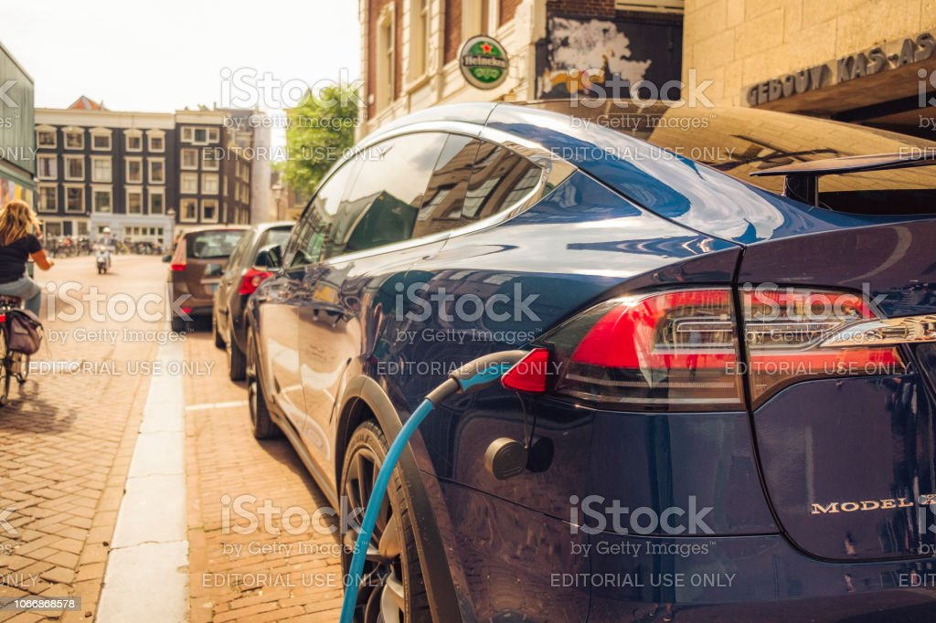 Tesla Model X charging on the street in Amsterdam stock photo