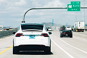 Phoenix, AZ, USA - May 6, 2016: Brand new white electric car Tesla Model X on the highway in Arizona.