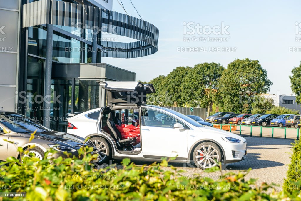 Tesla Model X P90D all-electric crossover SUV with open Falcon wing doors stock photo