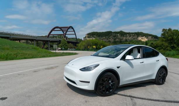 Tesla Model Y parked at Pennybacker Bridge stock photo