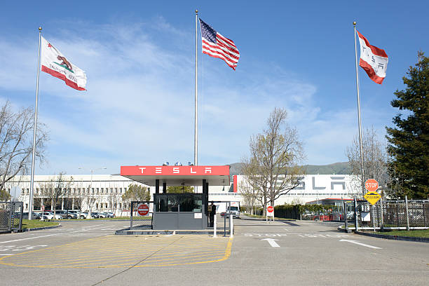 Tesla Motors Factory Fremont, California, USA - March 11, 2013: Entrance to the Tesla Motors factory where the Model S is currently being produced. tesla motors stock pictures, royalty-free photos & images