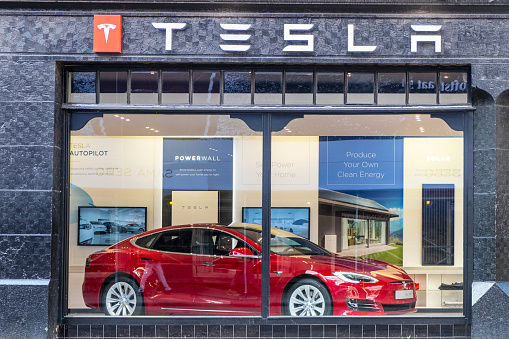 Tesla Showroom In Amsterdam With A Red Tesla Model S Electric Car On Display Inside Stock Photo - Download Image Now