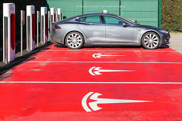 Tesla supercharger station and parking in Lyon Lyon, France - January 25, 2016: Tesla supercharger station and parking in Lyon. Tesla is an American automotive and energy storage company that designs, manufactures, and sells luxury electric cars tesla motors stock pictures, royalty-free photos & images