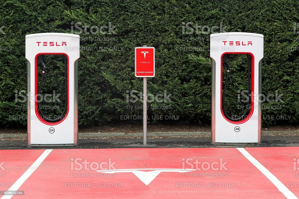 Tesla supercharger station and parking stock photo