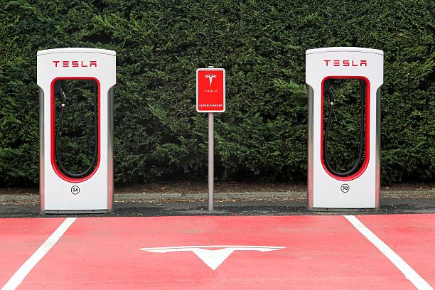 Tesla supercharger station and parking Lyon, France - October 22, 2016: Tesla supercharger station and parking. Tesla is an American automotive and energy storage company that designs, manufactures, and sells luxury electric cars tesla motors stock pictures, royalty-free photos & images