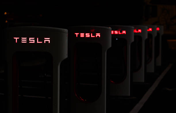Tesla Supercharger station Brenner, Italy - May 8, 2016: Tesla charging stations are located throughout EU to accommodate owners of the electric car. tesla motors stock pictures, royalty-free photos & images