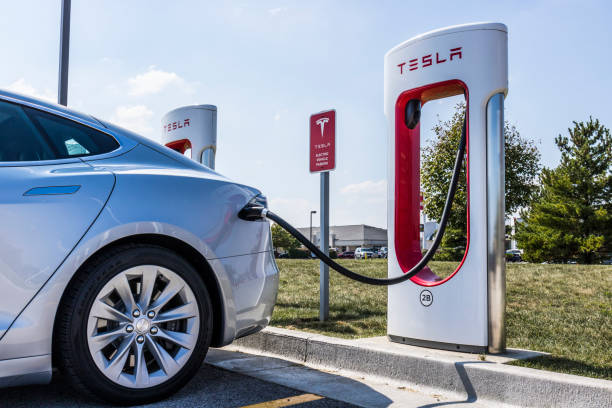 Tesla Supercharger Station. The Supercharger offers fast recharging of the Model S and Model X electric vehicles XI Lafayette - Circa September 2017: Tesla Supercharger Station. The Supercharger offers fast recharging of the Model S and Model X electric vehicles XI tesla motors stock pictures, royalty-free photos & images