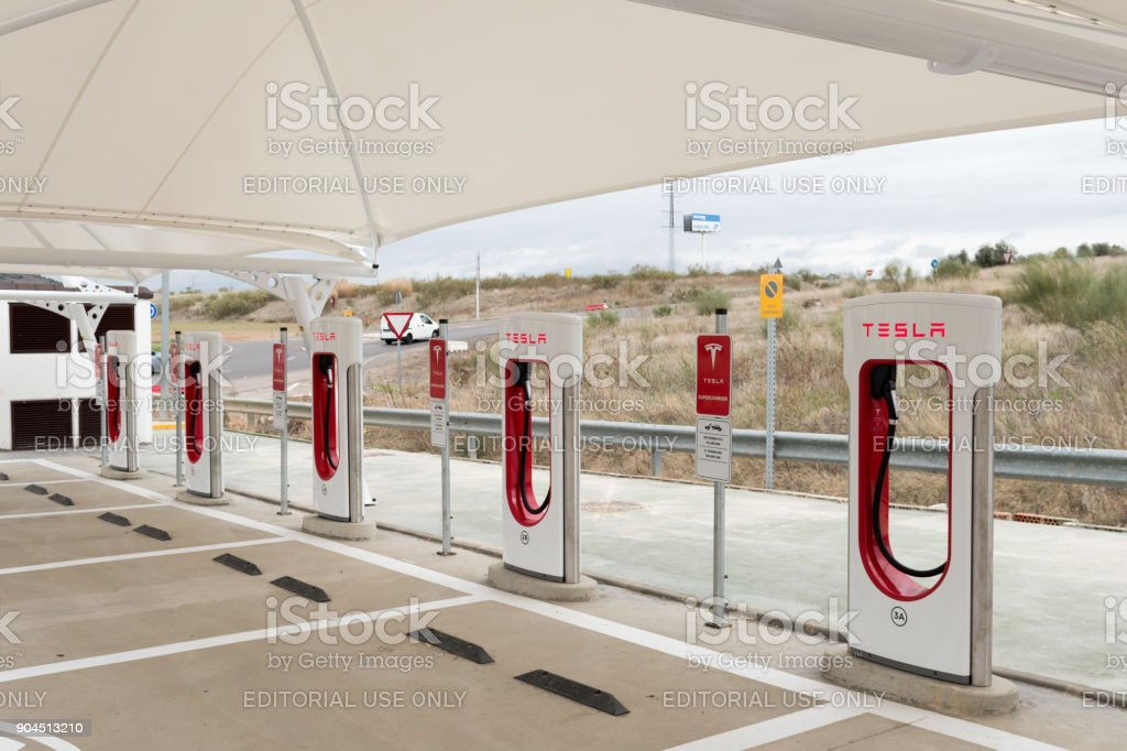 Tesla Supercharger stations and parking stock photo