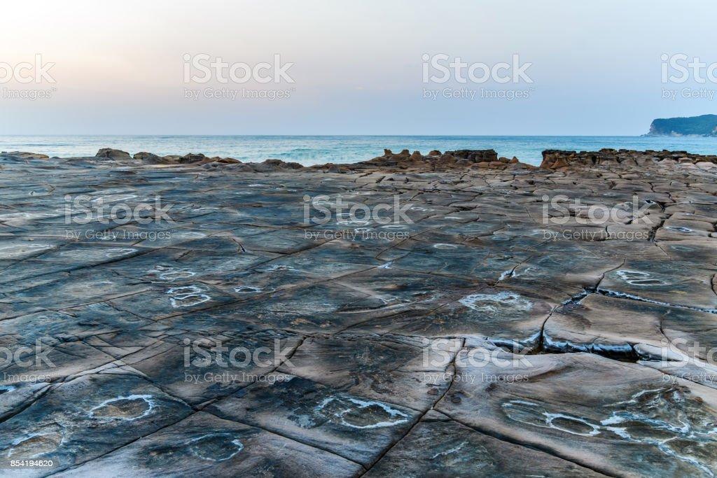 Tesselated Rock Platform Early Morning Seascape stock photo