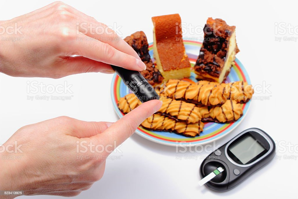 Test for determination level sugar and fresh pastry in background stock photo
