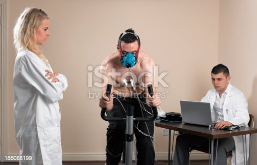 Athlete having a VO2 test with a VO2 mask on his face,, electrocardiogram pads attached,, on an exercise bike,, doctor monitoring his results on his laptop,, nurse watching that mask/electrodes. [url=file_closeup?id=14572476][img]/file_thumbview/14572476/1[/img][/url] [url=file_closeup?id=14570565][img]/file_thumbview/14570565/1[/img][/url] [url=file_closeup?id=17097857][img]/file_thumbview/17097857/1[/img][/url] [url=file_closeup?id=8456596][img]/file_thumbview/8456596/1[/img][/url] [url=file_closeup?id=3022535][img]/file_thumbview/3022535/1[/img][/url] [url=file_closeup?id=14261791][img]/file_thumbview/14261791/1[/img][/url] [url=file_closeup?id=3022297][img]/file_thumbview/3022297/1[/img][/url] [url=file_closeup?id=9000439][img]/file_thumbview/9000439/1[/img][/url] [url=file_closeup?id=27497958][img]/file_thumbview/27497958/1[/img][/url] [url=file_closeup?id=17220577][img]/file_thumbview/17220577/1[/img][/url] [url=file_closeup?id=14563258][img]/file_thumbview/14563258/1[/img][/url] [url=file_closeup?id=17674650][img]/file_thumbview/17674650/1[/img][/url] [url=file_closeup?id=14314391][img]/file_thumbview/14314391/1[/img][/url] [url=file_closeup?id=19813892][img]/file_thumbview/19813892/1[/img][/url] [url=file_closeup?id=14262186][img]/file_thumbview/14262186/1[/img][/url] [url=file_closeup?id=21444075][img]/file_thumbview/21444075/1[/img][/url] [url=file_closeup?id=11210615][img]/file_thumbview/11210615/1[/img][/url] [url=file_closeup?id=11878425][img]/file_thumbview/11878425/1[/img][/url] [url=file_closeup?id=11954875][img]/file_thumbview/11954875/1[/img][/url] [url=file_closeup?id=14108687][img]/file_thumbview/14108687/1[/img][/url] [url=file_closeup?id=11652699][img]/file_thumbview/11652699/1[/img][/url] [url=file_closeup?id=14188938][img]/file_thumbview/14188938/1[/img][/url] [url=file_closeup?id=17199853][img]/file_thumbview/17199853/1[/img][/url] [url=file_closeup?id=8379220][img]/file_thumbview/8379220/1[/img][/url]
