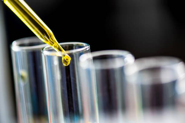 test tube containing chemical liquid in laboratory, lab chemistry or science research and development concept. - ricerca scientifica foto e immagini stock