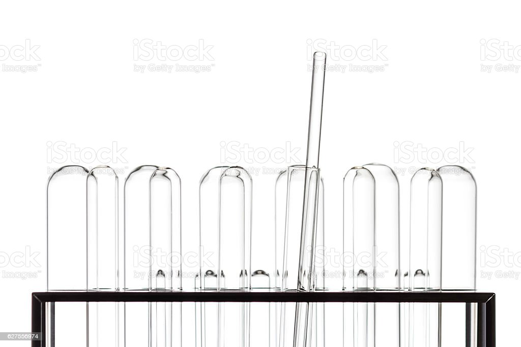 Test tube in rack with stirring rod on white background stock photo