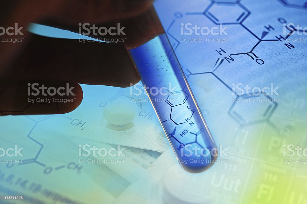 Test tube with formula inside in arm. stock photo