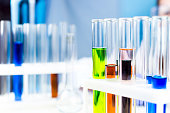 Test tube with toxic color liquid water in laboratory.