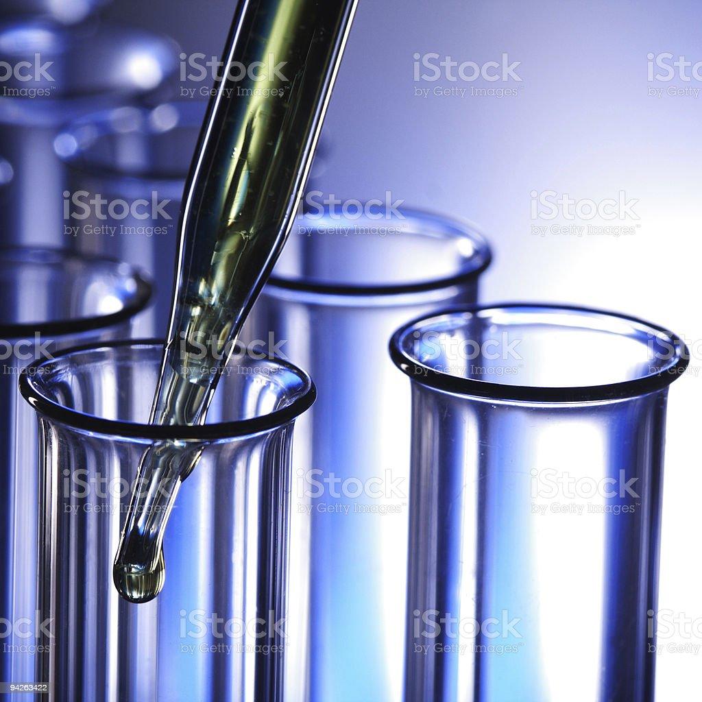 Test tubes and dropper on blue background royalty-free stock photo
