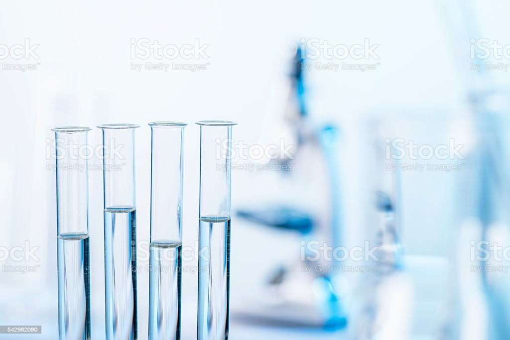 Test tubes and microscope in laboratory stock photo