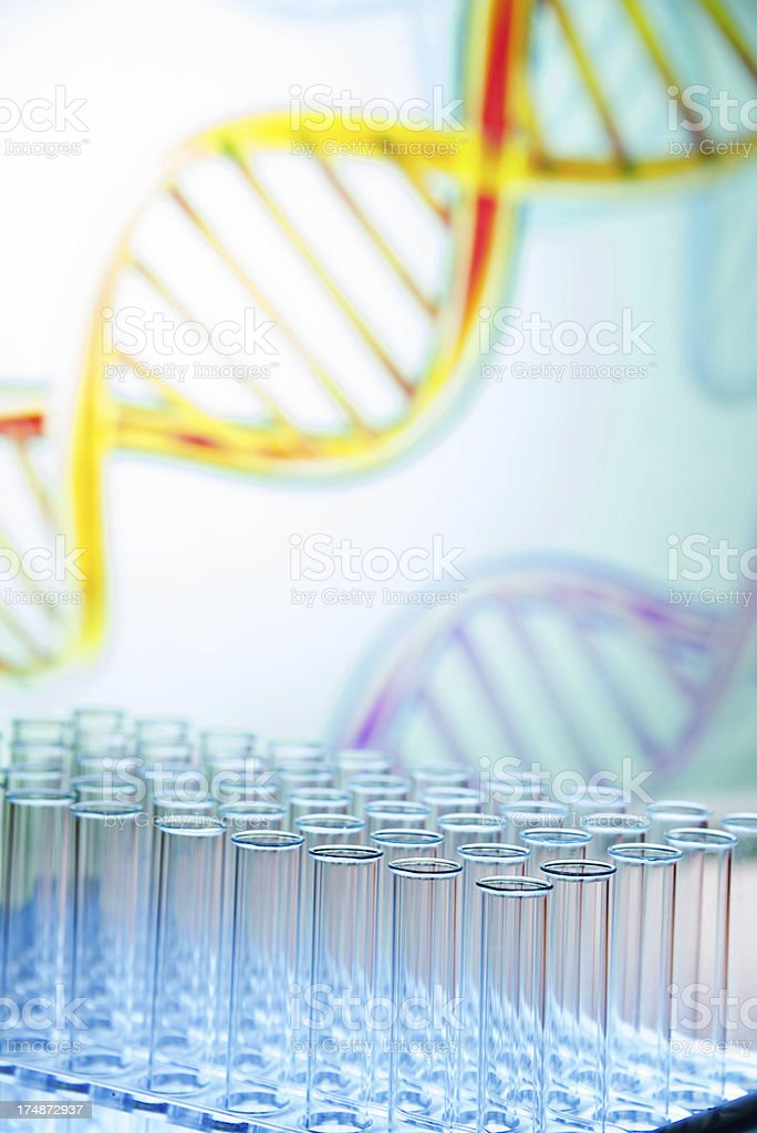 Test tubes in blue high key DNA background shallow dof royalty-free stock photo