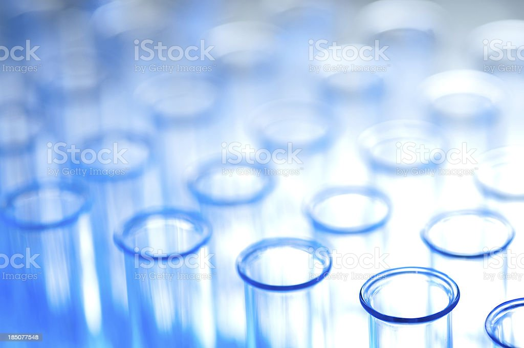 Test tubes  in blue high key shallow dof stock photo