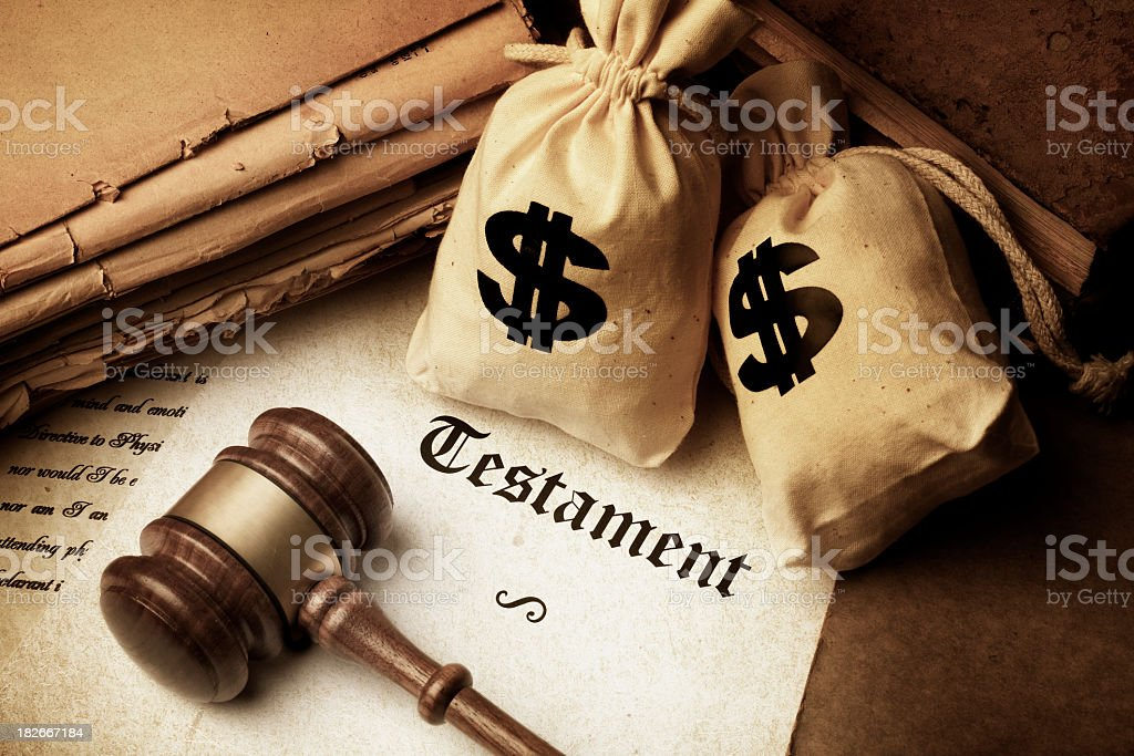 Testament gavel and sacks with dollar sign royalty-free stock photo