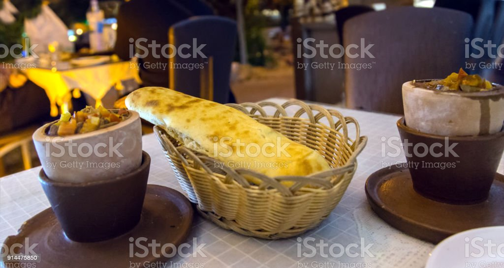 Testi Kebap is a meat and vegetable dish slow cooked in a sealed clay pot. stock photo