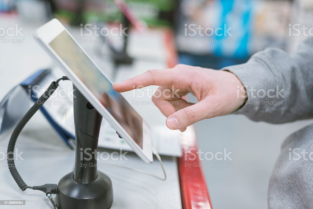 testing electronic tablet in store, consumerism concept stock photo