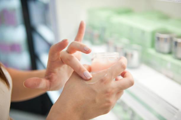 Testing hand cream in store stock photo